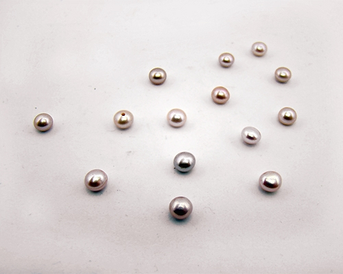 Perla botón 5mm. Malva
