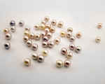 Perla esférica 5-5,5mm. Rosa o malva