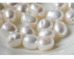 Perlas barrocas con perforación completa de 2mm. Blancas