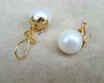 Pendientes de Perla AAAA 11-11,5mm. blanca y cierre omega Oro 750ml.