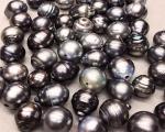 Perla Tahití barroca 12-13mm. con taladro completo de 2mm.