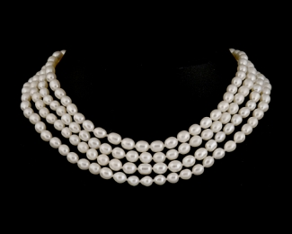 ^ Collar sin fin de 160cm. Perla oval blanca 6x7mm
