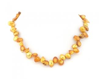 Perla blister dorada. Hilo 40cm.
